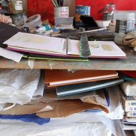 studio-sketch-books-and-collage-materials-taking-over-the-workspace